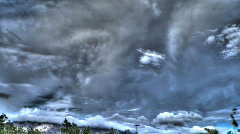 HDR Clouds Over a Mountain - stock footage