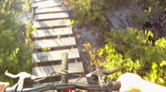 Stock Video Footage of Mountain Biking Over Jumps