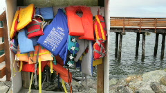 Life vests available to borrow at Marina in Oregon Stock Footage
