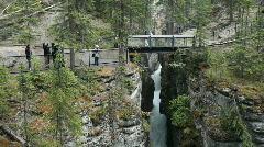 Maligne Canyon bridge tourists P HD 7633 Stock Footage