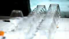 Focus on row of glass - sequence shot - stock footage