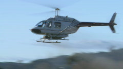 Close view as a helicopter sprays an orchard and turns  Stock Footage