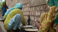Refugee Women Cooking Bread Stock Footage