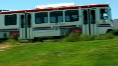 Trax Train Flyes By a Green Grass Field 1 Stock Footage