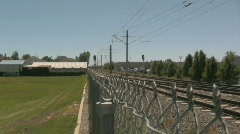 Looking Down a Chain Linked Fence With Train Trax 2 Stock Footage