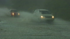 Flash flooded street with traffic plowing through - 8 Stock Footage