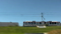 Two Trax Train Flyes By a Green Grass Field in Both Directions 2 Stock Footage
