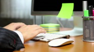 Businessman typing on computer keyboard at office Stock Footage