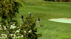 Hot Girl Golfer Walks to the Hole Stock Footage