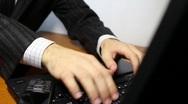 Businessman typing on laptop keyboard Stock Footage