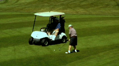 Old Man Hits a Golf Ball on the Course Stock Footage