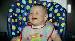 Baby boy at lunch time laughing, sound included - stock footage