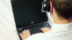 Support operator entering information on laptop computer Stock Footage