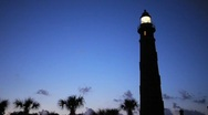 Stock Video Footage of Lighthouse and Palm Trees at dusk