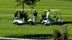 Golfers Golfing and Getting Into Their Golf Carts 1 Stock Footage