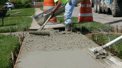 Consturction workers laying concrete Stock Footage