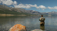 Fisherman with spinning catching fish in Khoton Nuur lake Stock Footage