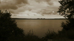 Eerie Sepia-tone Clouds over Water - stock footage