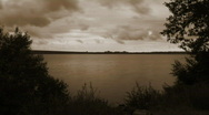 Eerie Sepia-tone Clouds over Water Stock Footage