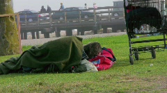 Hard Times-Homeless Man Sleeping in Park Stock Footage
