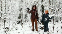 Woman and boy in snow forest Stock Footage