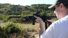 Shooting with a silencer Stock Footage