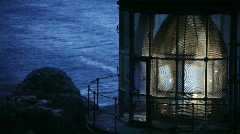 Heceta Head Lighthouse - View of Lamp Turning as Night Falls with Ocean View Stock Footage