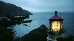 Heceta Head Lighthouse on Oregon Coast at Dusk - stock footage