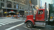 Garbage truck rumbles through the city Stock Footage