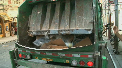 Trash compactor in back of truck - stock footage