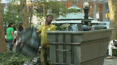 Park worker disposes of garbage (2 of 2) Stock Footage