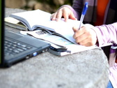 Female student studying with laptop, outdoors Stock Footage