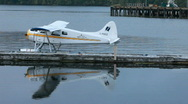 Float plane tied to pier P HD 0351 Stock Footage