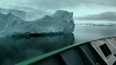 Ship sails past iceberg Stock Footage