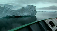Stock Video Footage of ship sails past iceberg