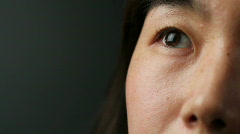 Korean woman's eyes, looking up Stock Footage