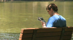 Man reads in the park (3 of 3) Stock Footage