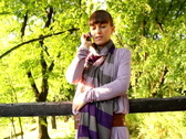 Woman with cellphone in the park Stock Footage