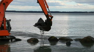 Tracked excavator at sea Stock Footage