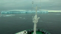 Ship sails through ice field in antarctica Stock Footage