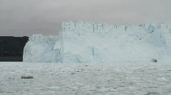 Sailing by the Eqi glacier Stock Footage