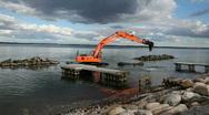 Stock Video Footage of Excavator working at sea