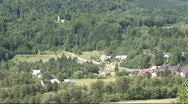 Village in forest slovenia Stock Footage