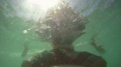 Underwater Surfer Waiting  Stock Footage