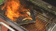 Stock Video Footage of Book burns consumed by  fire in barbecue grill