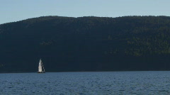 Boating 05: Sailboat across bay wide Stock Footage
