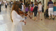 Young girl make music on the street Stock Footage