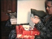 Stock Video Footage of Opening Christmas Presents (1958 Vintage 8mm film)