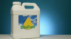 Container of biofuel with beaker of corn Stock Footage