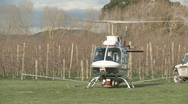 Helicopter with spray boom liftoff  Stock Footage